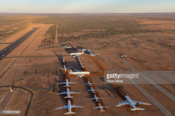 Grounded aeroplanes which include Airbus A380s Boeing MAX 8s and other smaller aircrafts are seen at the Asia Pacific Aircraft Storage facility on...
