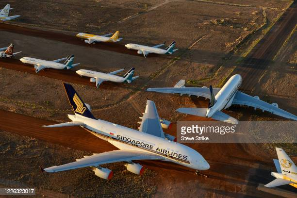 Grounded aeroplanes which include Airbus A380s, Boeing MAX 8s and other smaller aircrafts are seen at the Asia Pacific Aircraft Storage facility on...