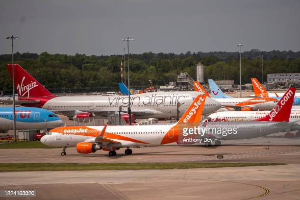 Grounded aircraft are seen at Manchester Airport on May 11 2020 in Manchester United Kingdom The Prime Minister announced the general contours of a...