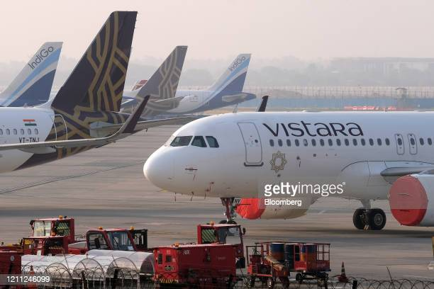 Grounded aircraft stand at Terminal 3 at the Indira Gandhi International Airport during a lockdown implemented due to the coronavirus in New Delhi,...