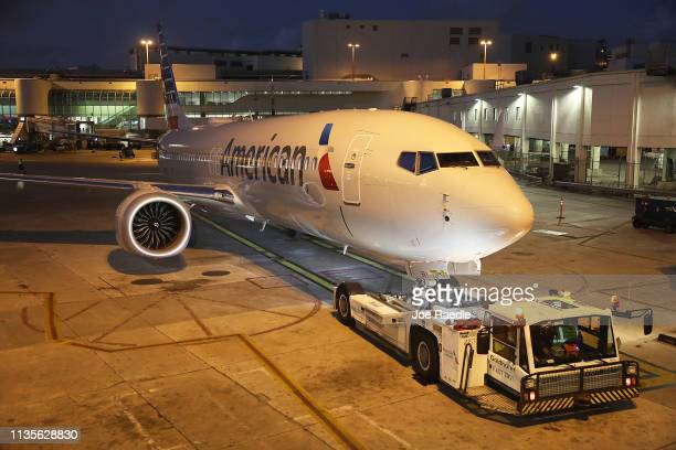 A grounded American Airlines Boeing 737 Max 8 is towed to another location at Miami International Airport on March 13 2019 in Miami Florida American...