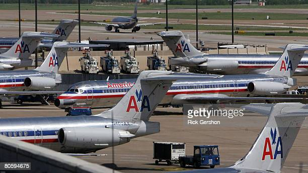 Grounded American Airlines MD80 aircraft sit on the tarmac April 10 2008 at the Dallas Fort Worth International Airport in Irving Texas American...
