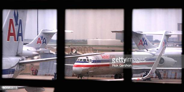 Grounded American Airlines MD80 aircraft sit on the tarmac April 9 2008 at the Dallas Fort Worth International Airport in Irving Texas American...