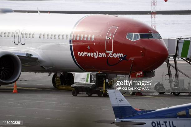 A grounded Boeing 737 MAX 8 passenger plane of the Norwegian lowcost airline Norwegian is parked at the tarmac at Vantaa airport in Vantaa near...