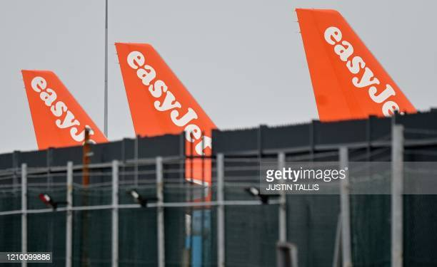 Grounded EasyJet aircraft are pictured on the apron at London Luton Airport north of London on April 16 2020 EasyJet will likely keep its middle...