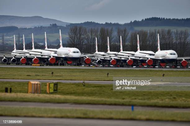 Grounded fleet of British Airway planes sit on the runway at Glasgow Airport on March 21, 2020 in Glasgow, Scotland. Coronavirus has spread to at...