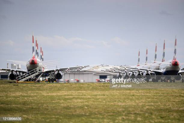 A grounded fleet of British Airway planes sit on the runway at Glasgow Airport on March 21 2020 in Glasgow Scotland Coronavirus has spread to at...