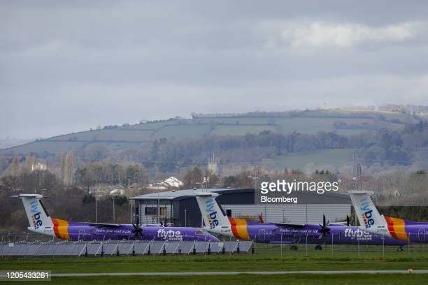 Grounded passenger aircraft featuring the Flybe Group Plc livery sit on the tarmac at Exeter Airport Exeter UK on Friday March 6 2020 Flybe Britain's...