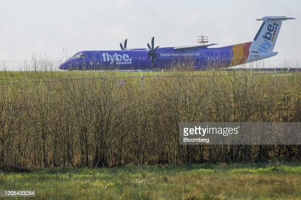 A grounded passenger aircraft featuring the Flybe Group Plc livery sits on the tarmac at Exeter Airport Exeter UK on Friday March 6 2020 Flybe...