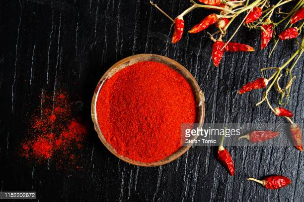 grounded red paprika in a bowl - paprika stock pictures, royalty-free photos & images