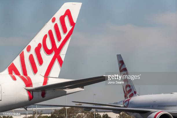 Grounded Virgin planes are seen parked on a tarmac at Brisbane Airport on April 21, 2020 in Brisbane, Australia. Australia's second largest airline...