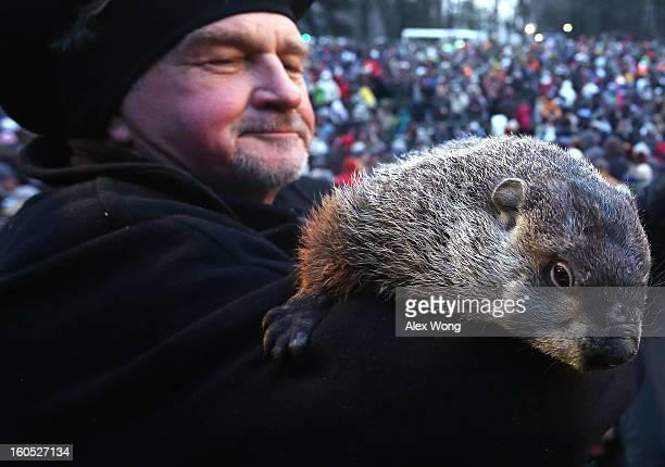 Groundhog cohandler John Griffiths holds Punxsutawney Phil after Phil did not see his shadow and predicting an early spring during the 127th...