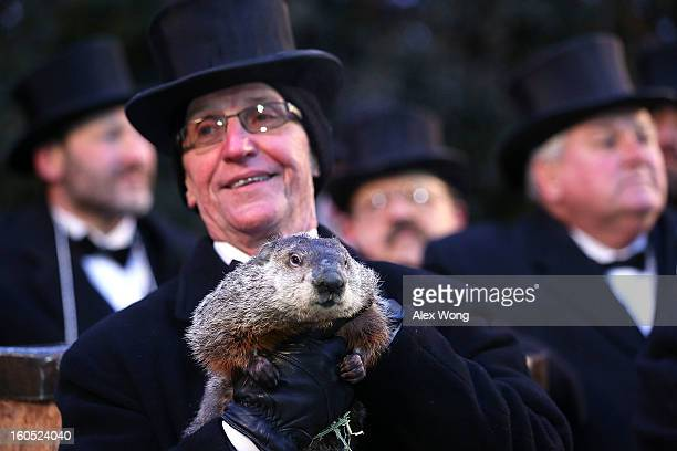 Groundhog cohandler Ron Ploucha holds Punxsutawney Phil after Phil didn't see his shadow and predicting an early spring during the 127th Groundhog...