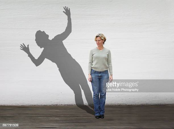 groundhog day: a woman and her shadow - funny groundhog stock photos and pictures