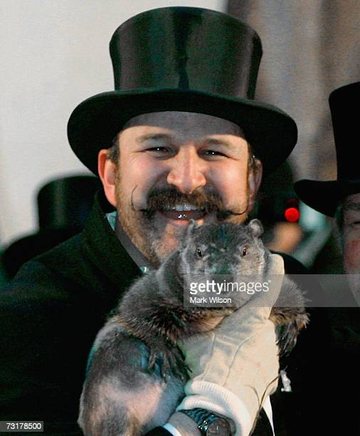 Groundhog handler Ben Hughes holds Punxsutawney Phil before which he didnt see his shadow and predicting a early spring during festivities February 2...