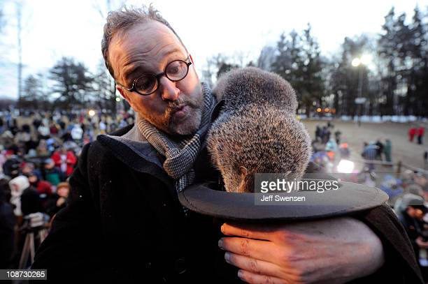 Groundhog handler Ben Hughes watches Punxsutawney Phil after he did not see his shadow predicting an early spring during the 125th annual Groundhog...