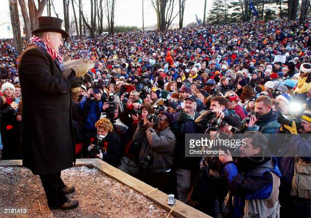 Groundhog handler Bill Deeley presents Phil to the crowd February 2 2002 during the annual Groundhog day event in Punxsutawney Pa Punxsutawney Phil...