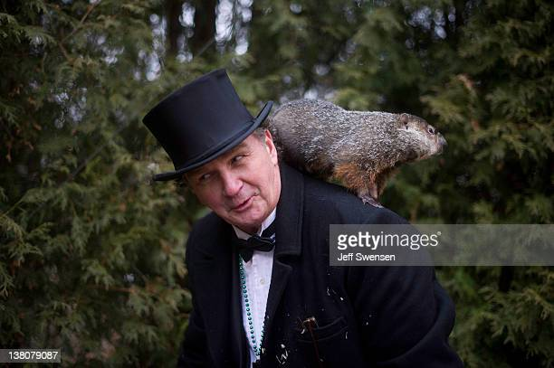 Groundhog handler John Griffiths holds Punxsutawney Phil after he saw his shadow predicting 6 more weeks of winter during 126th annual Groundhog Day...