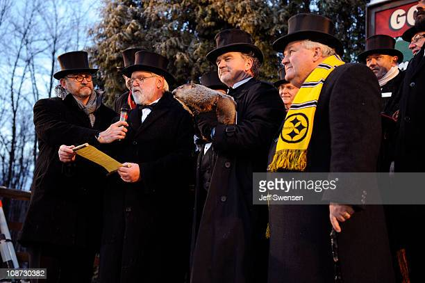 Groundhog handler John Griffiths holds Punxsutawney Phil while members of the Inner Circle read the proclamation after Phil did not see his shadow...