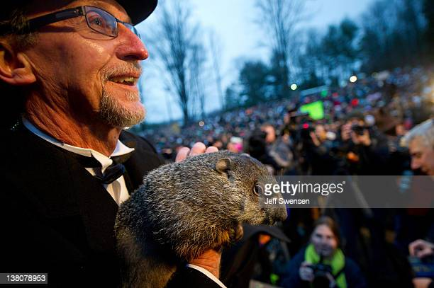 Groundhog handler Ron Ploucha holds Punxsutawney Phil after he saw his shadow predicting 6 more weeks of winter during the 126th annual Groundhog Day...