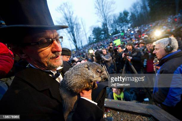 Groundhog handler Ron Ploucha holds Punxsutawney Phil after he saw his shadow predicting 6 more weeks of winter during 126th annual Groundhog Day...