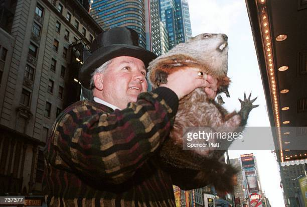 Groundhog handler William Deeley holds up Punxsutawney Phil a groundhog January 30 2001 at a Manhattan New York hotel Punxsutawney Phil was in town...