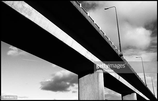 CONTENT] A groundlevel picture of a motorway flyover in Newport taken against the sky High contrast strong lines