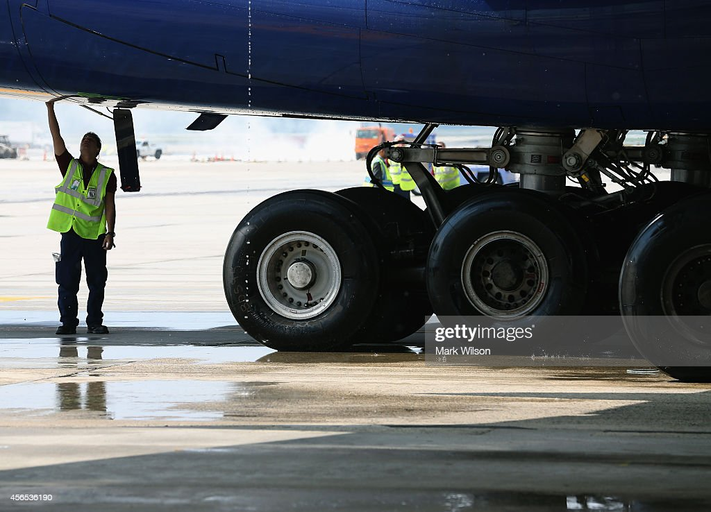 A grounds crew attends the British Airways' new super jumbo Airbus A380 after it arrived at Washington Dulles International Airport October 2, 2014 in Dulles, Virginia. British Airways introduced the first Airbus A380 nonstop service between London Heathrow and Washington Dulles International Airport.