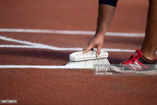 A grounds crew member touches up the batter's box paint prior to a game at Fenway Park in Boston on Apr 12 2017 Players think about the history every...