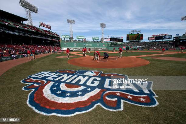 Grounds crew prepare the field for an opening day game between the Boston Red Sox and the Pittsburgh Pirates at Fenway Park on April 3 2017 in Boston...