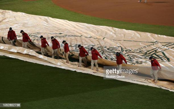Grounds crew took the tarp off the field The Boston Red Sox host the LA Dodgers in Game 1 of the World Series at Fenway Park in Boston on Oct 23 2018
