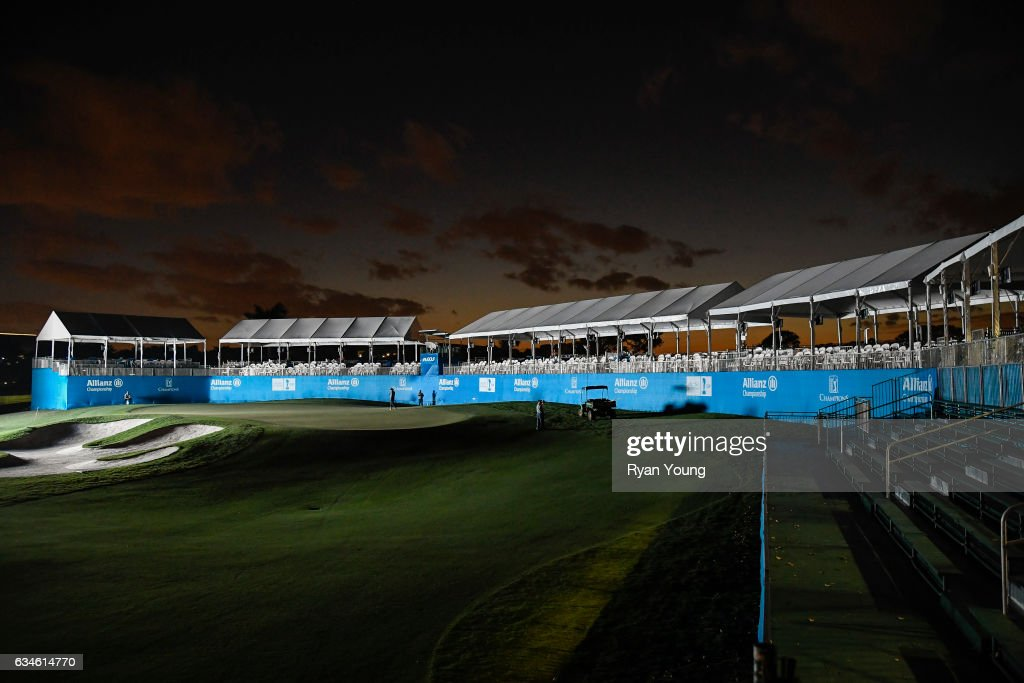 Grounds crews work on the 18th green as it is illuminated by a scoreboard following the first round of the PGA TOUR Champions Allianz Championship at The Old Course at Broken Sound on February 10, 2017 in Boca Raton, Florida.