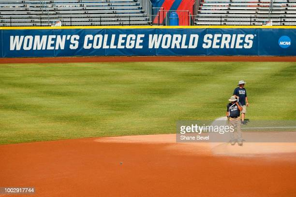 Grounds keepers water the infield prior to game two of the Division I Women's Softball Championship held at USA Softball Hall of Fame Stadium OGE...