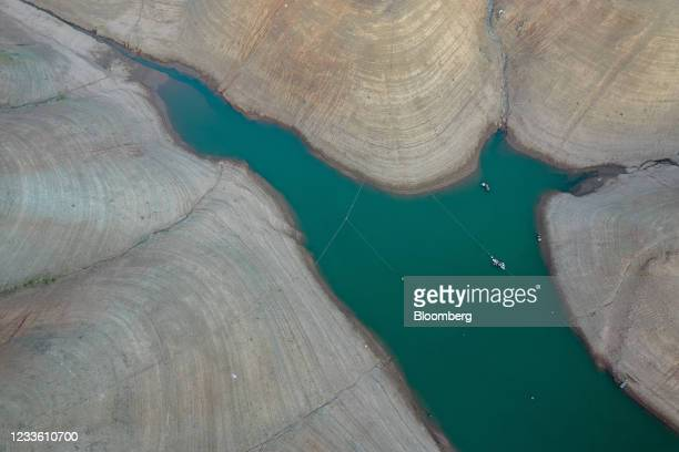 Grounds marked with previous water levels at Oroville Lake in Oroville, California, U.S., on Tuesday, June 22, 2021. Almost three-fourths of the...