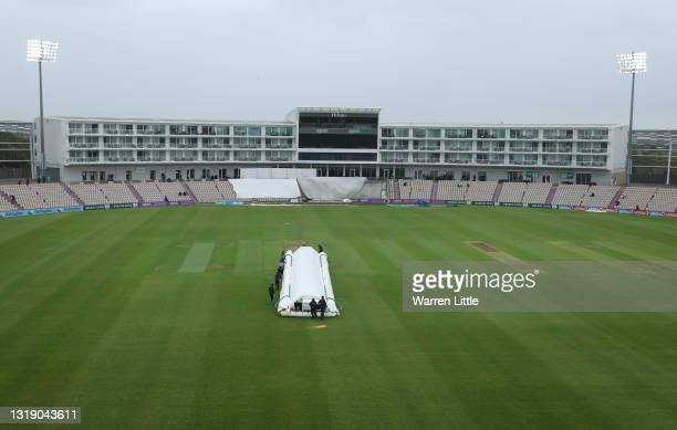 Grounds staff cover the wicket as rain delays the LV=Insurance County Championship match between Hampshire and Leicestershire at Ageas Bowl on May...