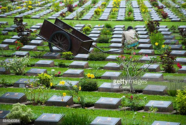 Groundskeeper at Kanchanaburi War Cemetery in Thailand
