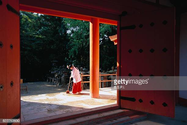Groundskeeper Sweeping Floor at Kasuga Taishi Shrine