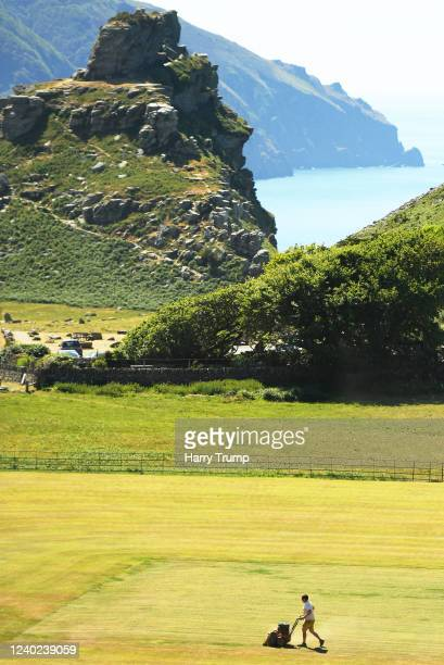 Groundsman Alex Spice works on the square at Lynton and Lynmouth Cricket Club on June 1, 2020 in Lynton, England. The coronavirus and the disease it...