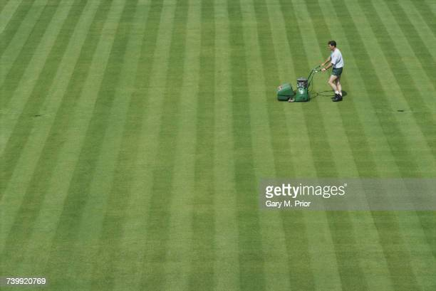 A groundsman cuts the grass on the Centre Court in preperation for the Wimbledon Lawn Tennis Championships on 19 June 1994 at the All England Lawn...
