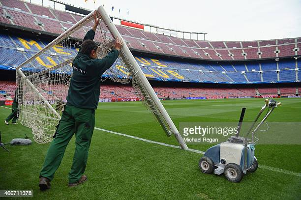 Groundsman erect the goal posts prior to the UEFA Champions League Round of 16 second leg match between Barcelona and Manchester City at Camp Nou on...