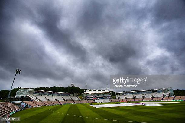 Groundsman inspect the pitch as rain delays the start of play on Day 1 of the LV County Championship Division One match between Hampshire and...
