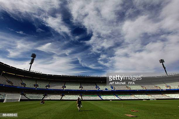 Groundsman makes final preparations to the pitch at Free State Park on June 13, 2009 in Bloemfontein, South Africa.
