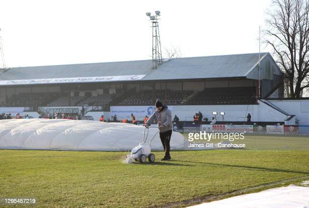 Groundsman of Chorley prepares the pitch prior to the FA Cup Third Round match between Chorley and Derby County at Victory Park on January 09, 2021...