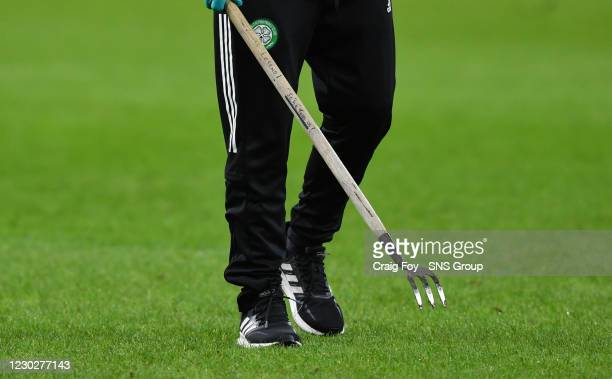 Groundsman on the pitch at half time during a Scottish Premiership match between Celtic and Ross County at Celtic Park, on December 23 in Glasgow,...