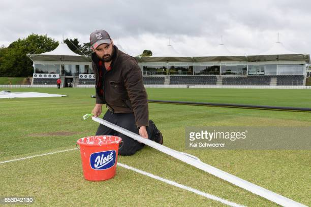 A groundsman paints the crease prior to the Plunket Shield match between Canterbury and Otago on March 14 2017 in Christchurch New Zealand