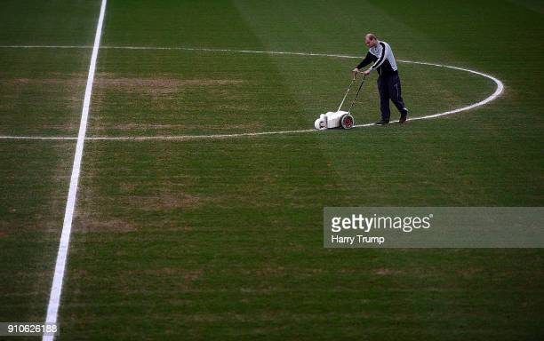 Groundsman paints the lines prior to kick off during The Emirates FA Cup Fourth Round match between Yeovil Town and Manchester United at Huish Park...