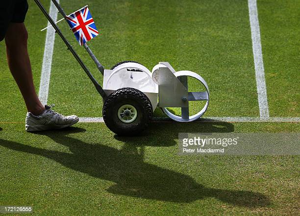 Groundsman paints the white lines on the grass of Centre Court at the Wimbledon Lawn Tennis Championships on July 1, 2013 in London, England. The...