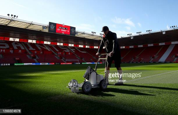 A groundsman prepares the pitch ahead of the Premier League match between Southampton FC and Wolverhampton Wanderers at St Mary's Stadium on January...
