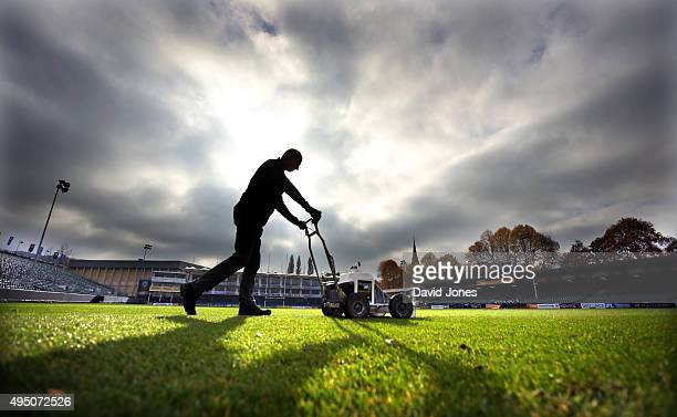A groundsman prepares the pitch before the Aviva Premiership match between Bath Rugby and Harlequins at the Recreation Ground on October 31 2015 in...