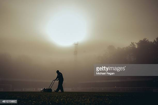 A groundsman prepares the pitch before the FA Cup Third Round match between Dover Athletic and Crystal Palace on January 4 2015 in Dover England